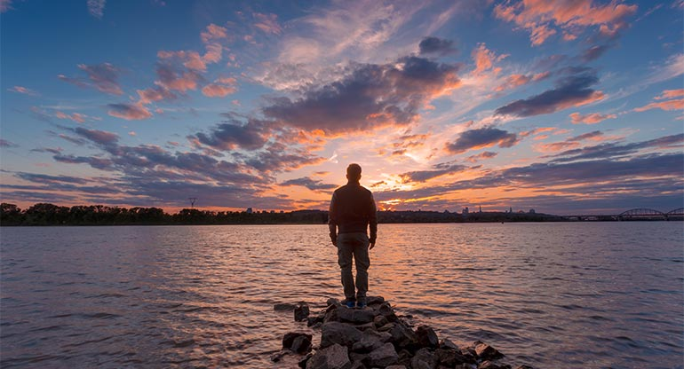 silhouette of man at sunrise, best all-natural moisturizer ingredients