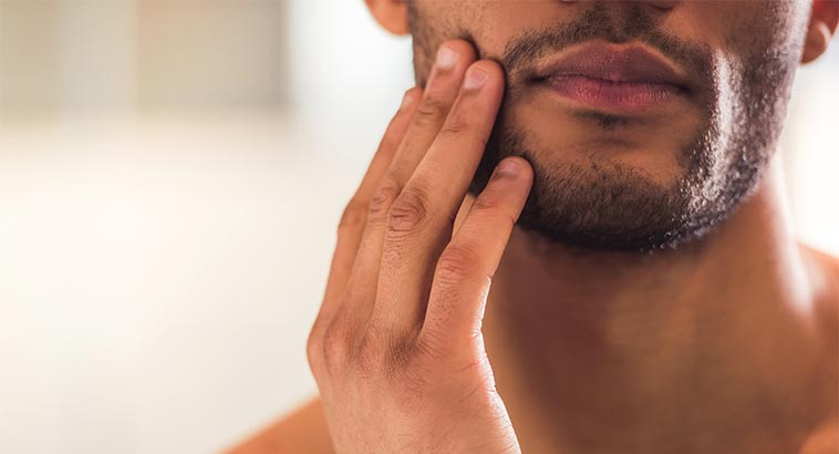 Best Natural Moisturizers, Man Touching Face