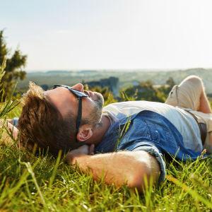 man relaxing outdoors, self-care activities