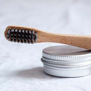 use a bamboo toothbrush to reduce plastic pollution