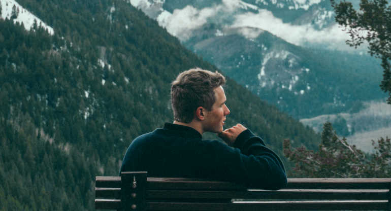 Best All Natural Lotion For Dry Skin, Young Man Looking At Snow Covered Mountains